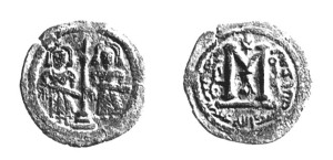 Abd al-Malik, 685. Keerzijde: Bismillāh. 'Abd allāh 'Abd al-Malik, amīr al-mu'minīn. 'In naam van God, De knecht Gods, Abd al-Malik, bevelhebber der gelovigen'